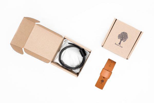 pasek na nogawkę zapakowany w ekologiczne, tekturowe pudełko